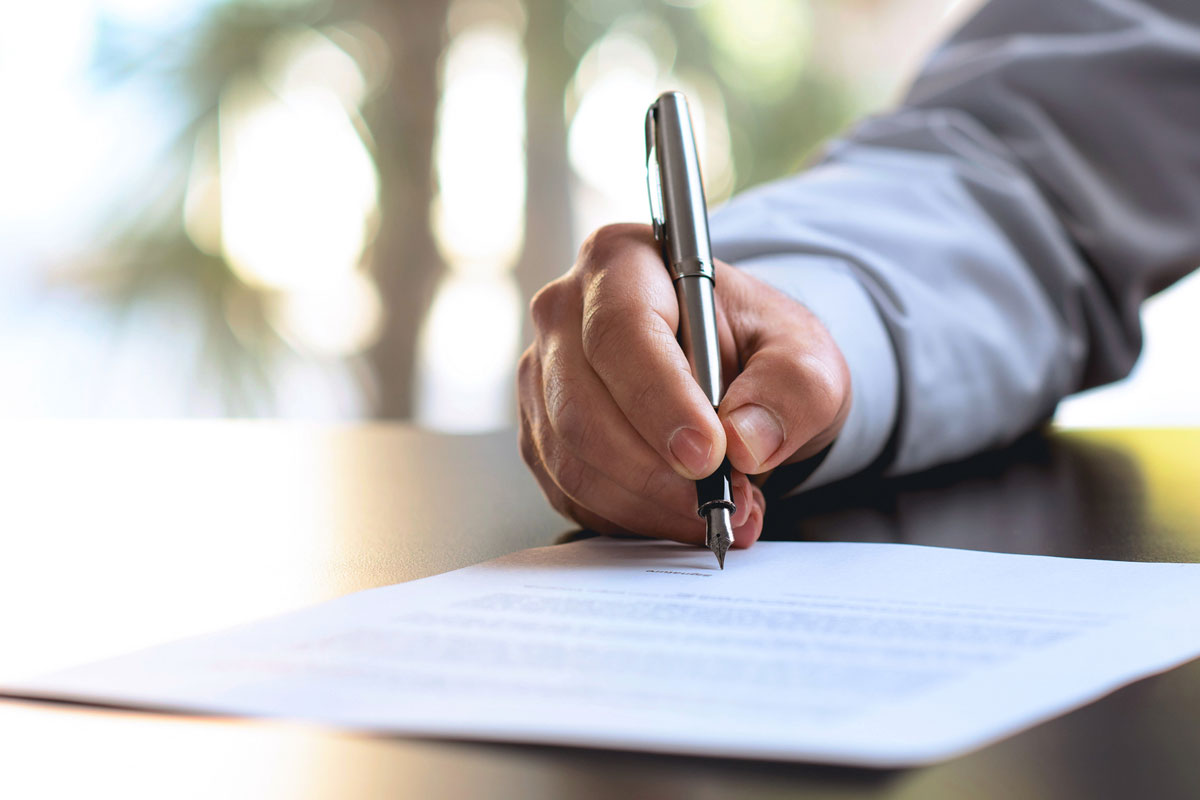 person-signing-papers